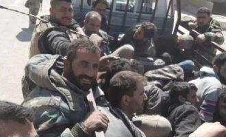 Δεκαπέντε τζιχαντιστές της Φαϊλάκ Αλ Ραχμάν παραδόθηκαν στον στρατό στην Αν. Δαμασκό (φωτο)