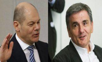 Deutsche Welle: Ο Σολτς θέλει λύση στο θέμα του ελληνικού χρέους