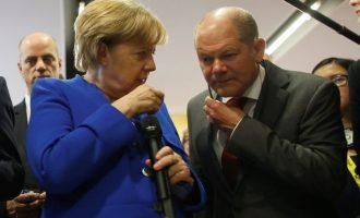 DW: «Αναίμακτη» λύση για την Ελλάδα θέλουν Μέρκελ-Σολτς