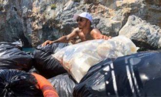 Μύκονος: Δείτε τον Λιούις Χάμιλτον να πετάει τα σκουπίδια ολόκληρης παραλίας (βίντεο)